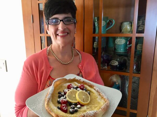 Kim prepared individual Dutch Babies for each guest when she job shadowed the innkeepers at Adventure Inn Bed and Breakfast.