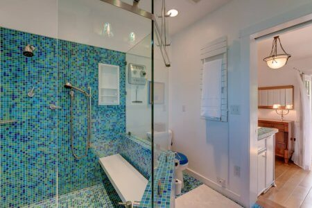 Very large custom-tile shower with multiple shower heads at Spring Lighthouse.