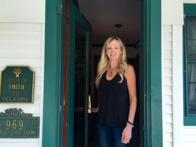 Innkeeper Jan Smith, Maple Cove B&B, at the B&B's front door.