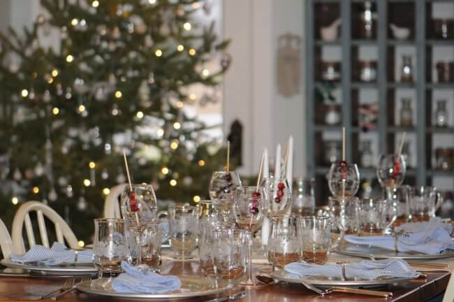 Beautiful table setting with Christmas tree in background at farmhouse B&B in Gladstone.
