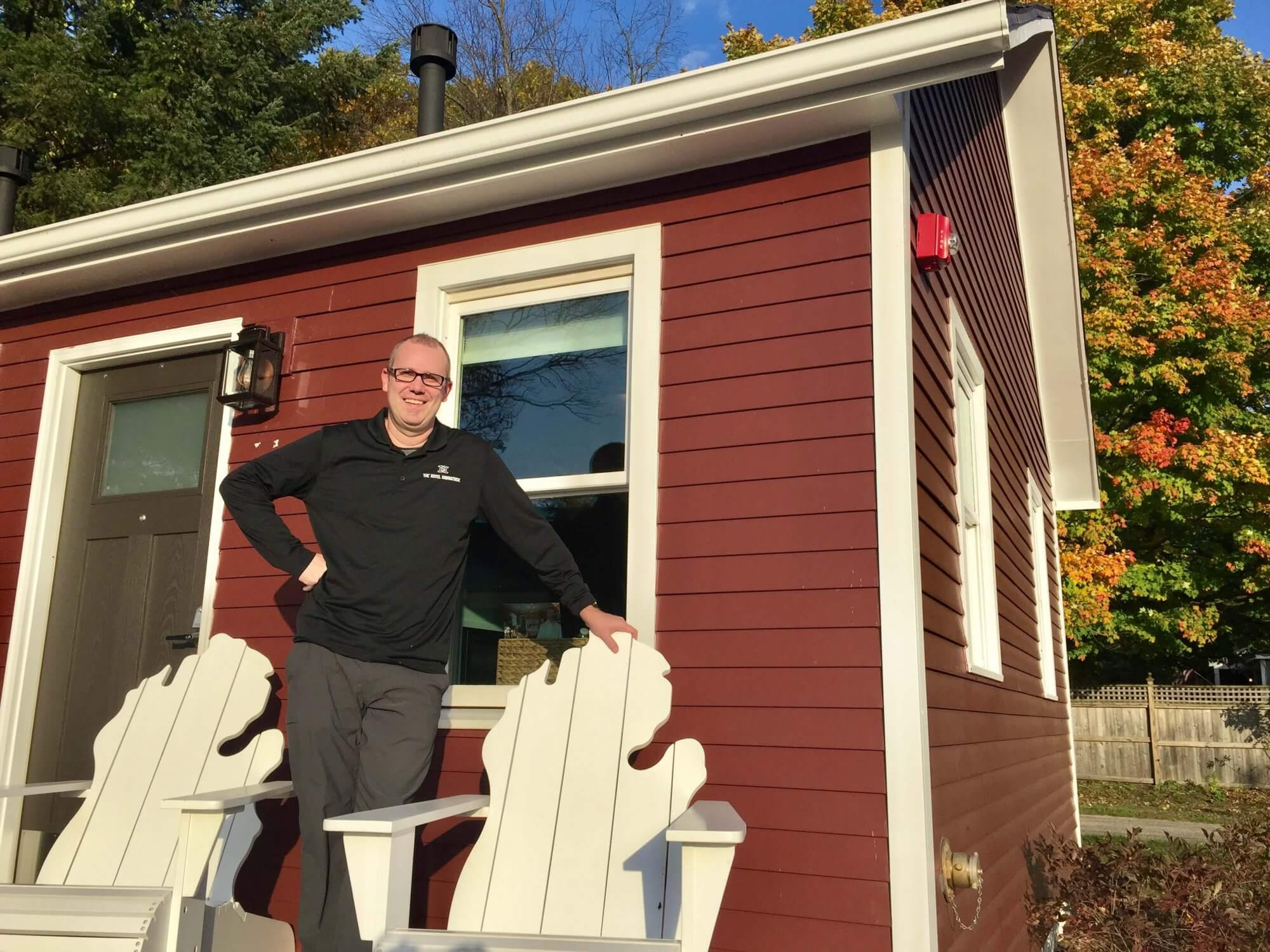 Owner Al Heminger outside one of the bungalows at Hotel Saugatuck