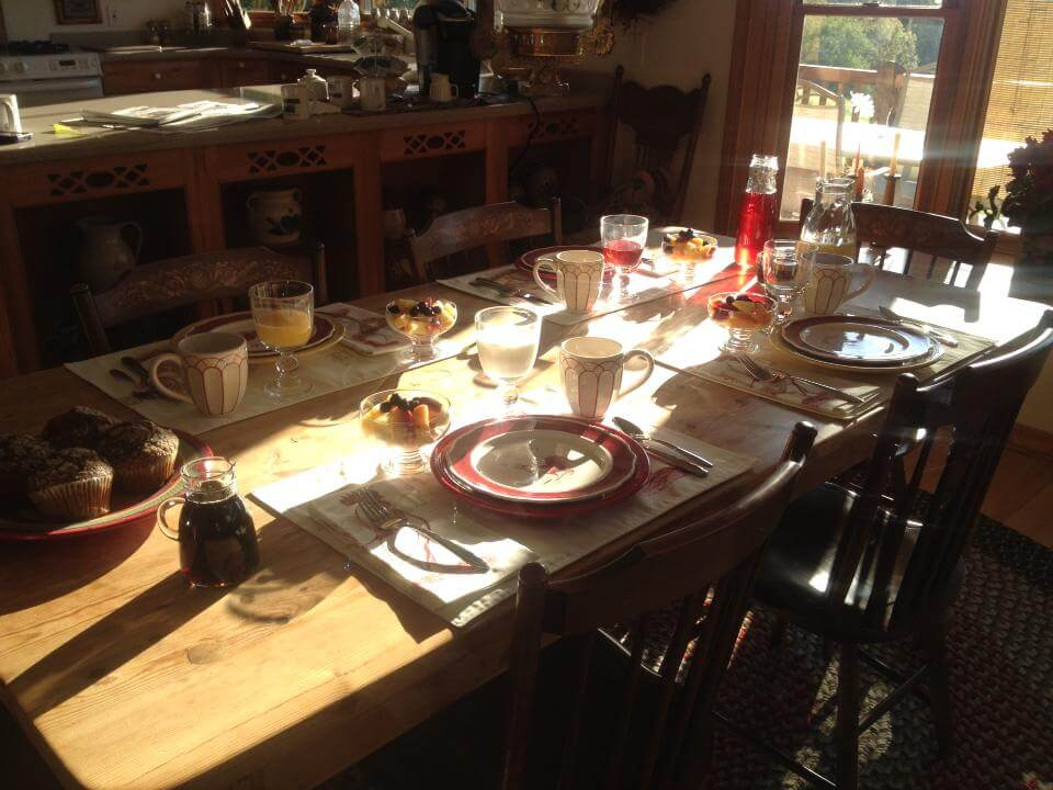 Guests will experience life off the grid at LogHaven B&B, but will find all the comforts and conveniences they expect. Breakfast table at LogHaven.