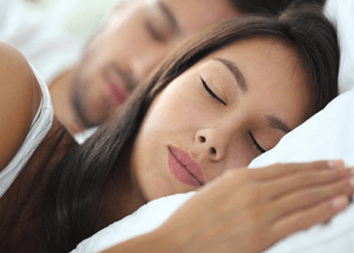 Couple sleeping in a bed