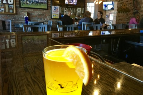 Glass of Michigan craft beer in a pub