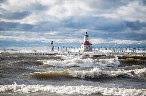 Lake Michigan surf pounds lighthouse