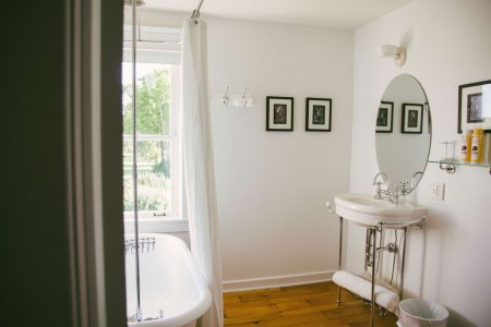 West Suite bathroom has clawfoot tub and a view of the farm.