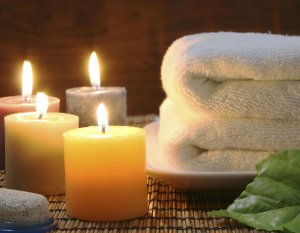Cocoa Cottage Massage Package candles with folders towels.