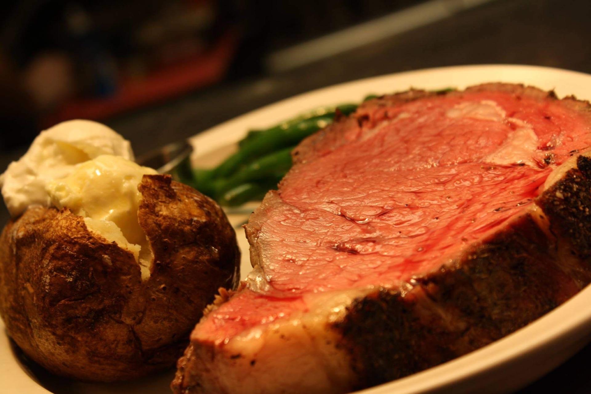 Steak and baked potato served at Olivia's Chop House, Jonesville