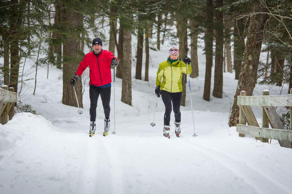 Couple enjoying cross country skiing at Muskegon Winter Sports Complex.