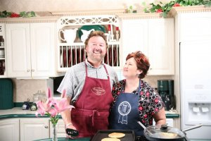 Cheri and Paul Antozak in the kitchen at Prairieside Suites
