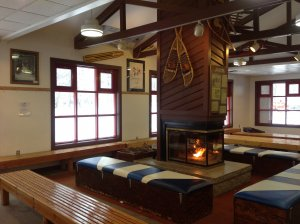 Warm-up by the fire in the lounge at the Muskegon Winter Sports Complex.