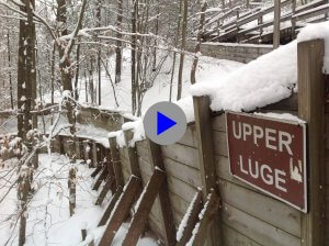 Image of the Upper Luge at the Muskegon Winter Sports Complex which links to a video of a luge run.