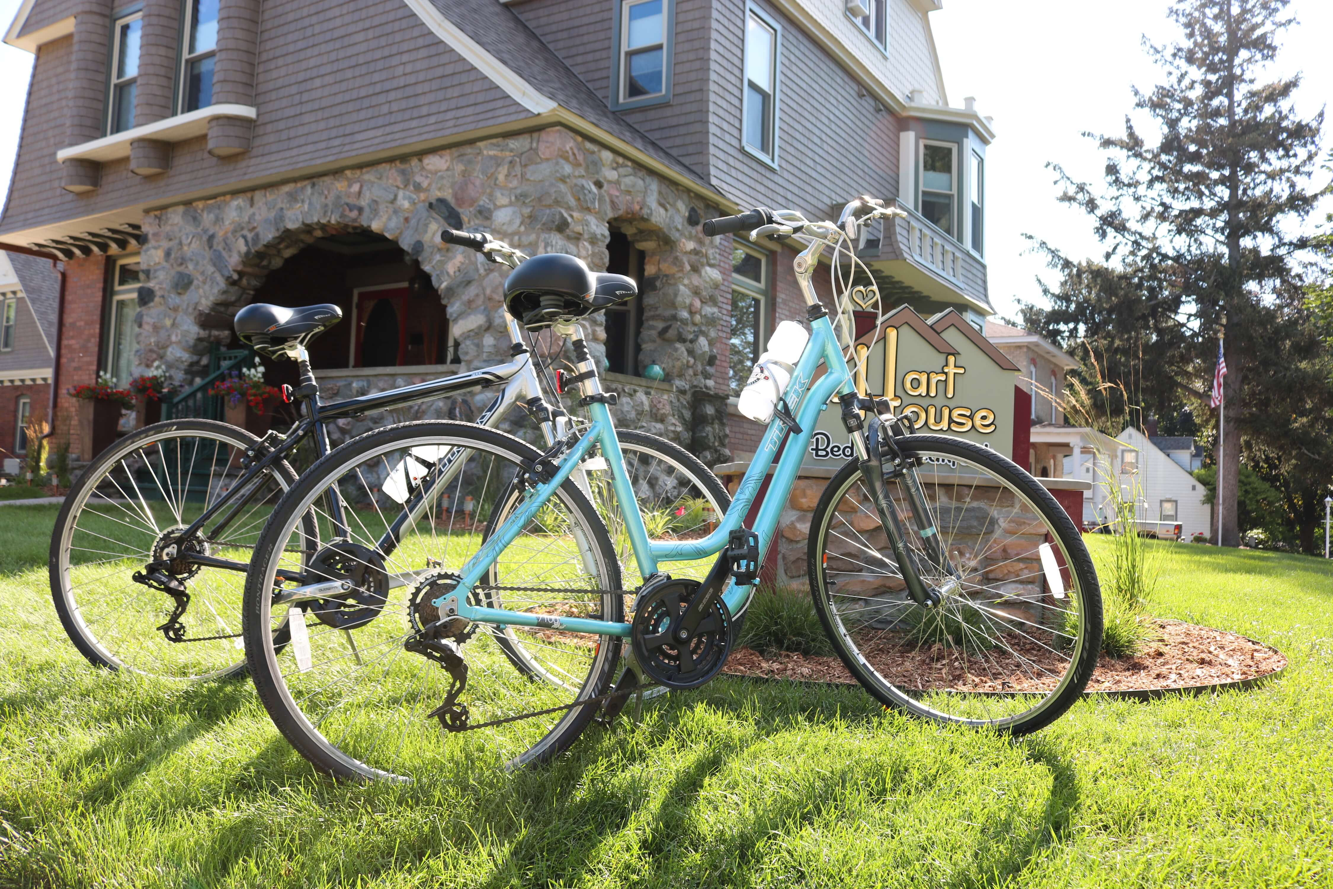 Bicycles sit on the lawn outside Hart House B&B