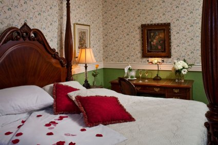 Room #5 at Kalamazoo House B&B with silk rose petals on the bed