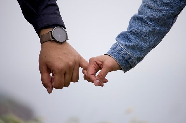 Couple holding hands. Photo illustration.