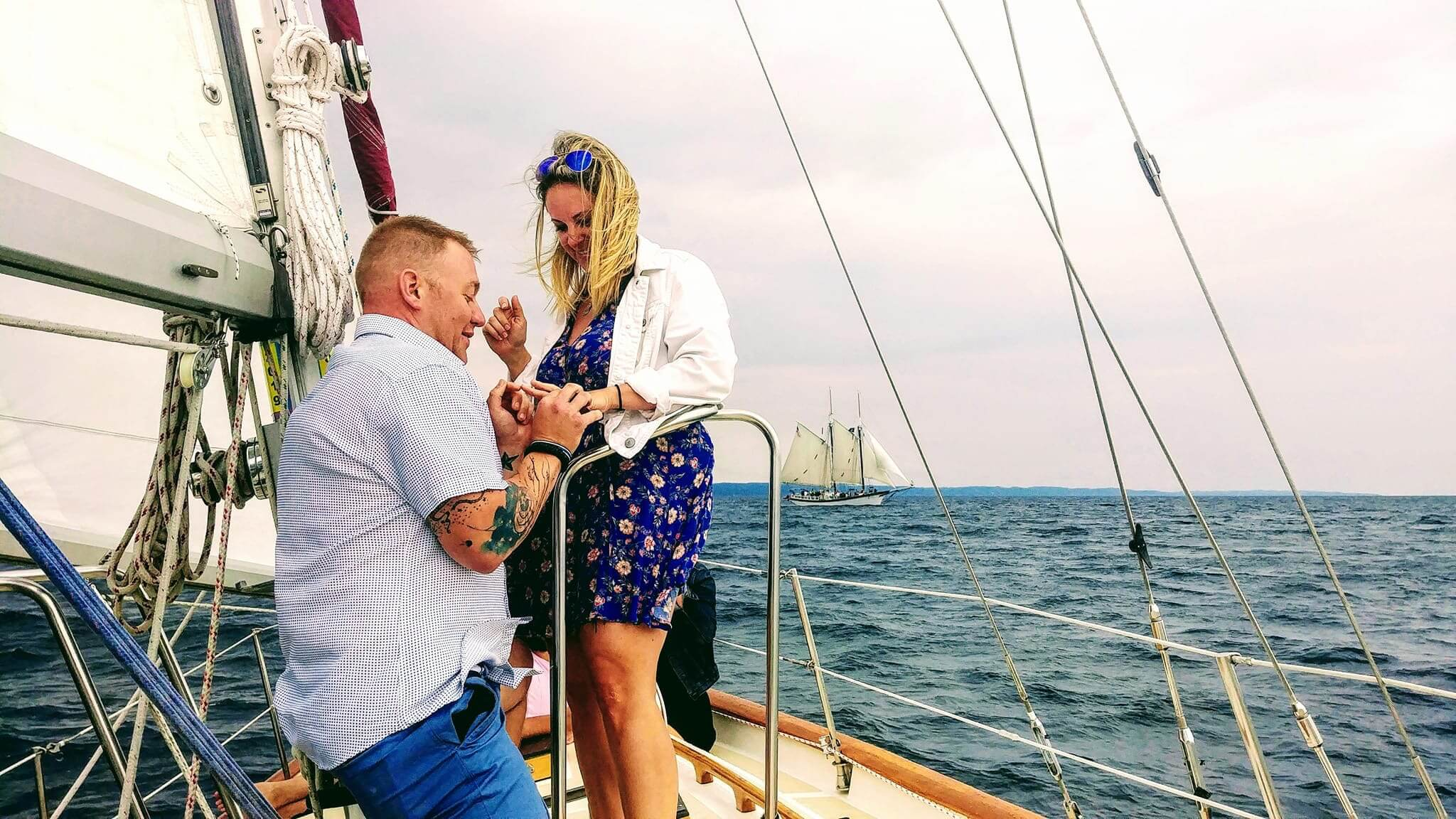 Loving couple get engaged aboard Sailing Yacht Scout in Grand Traverse Bay