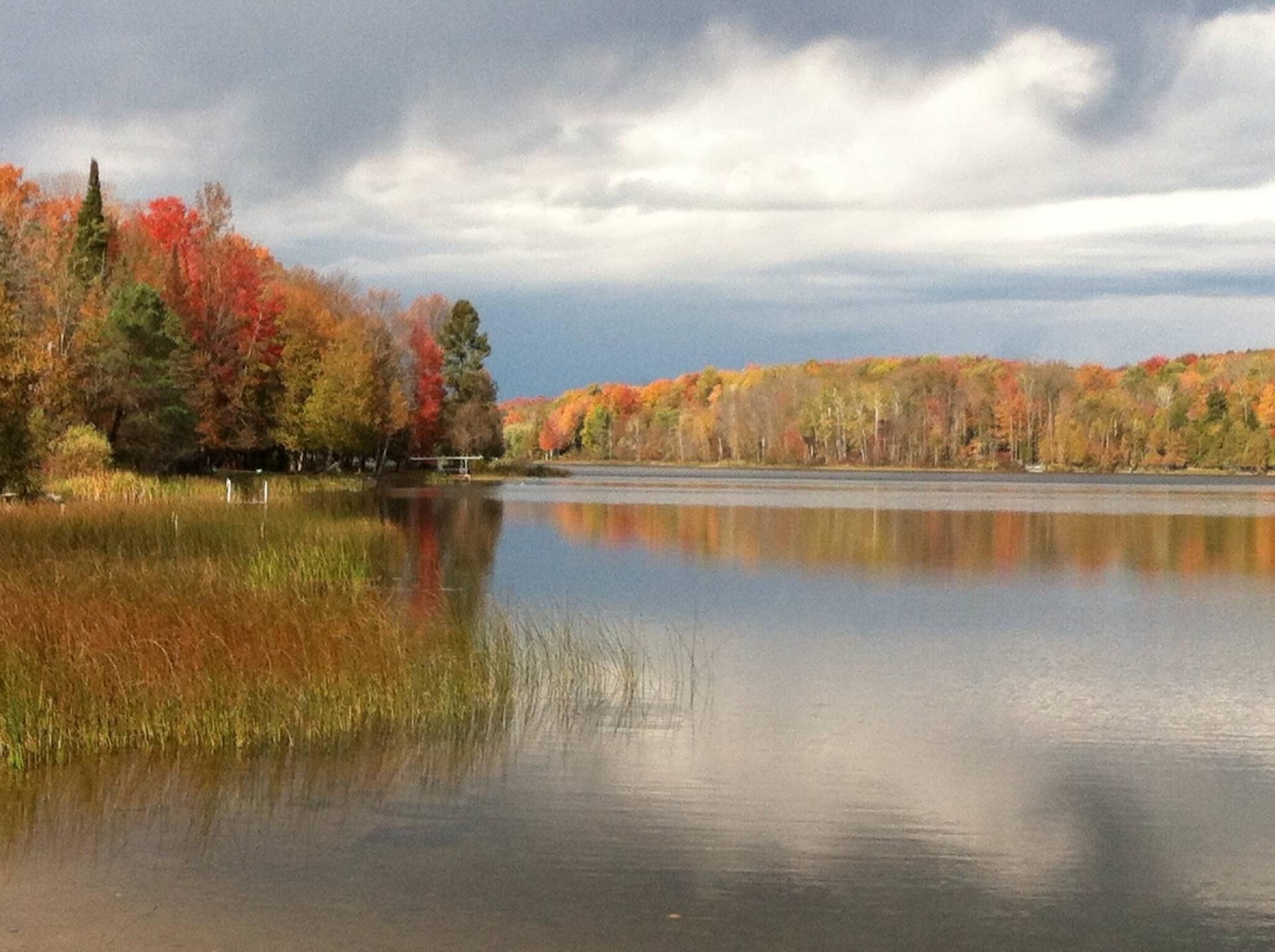 For an autumn adventure in Michigan, visit Torch Lake in its fall colors, close to Bridgewalk B&B