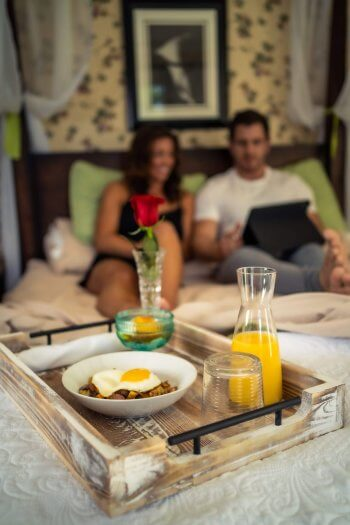 Bed in Breakfast with couple in the background