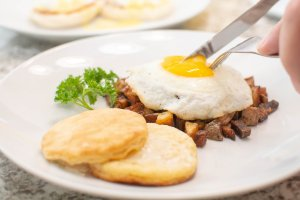 Poatato Hash with Sunny Side up Egg and biscuits