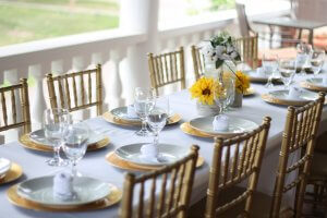 Tables set for event on the porch