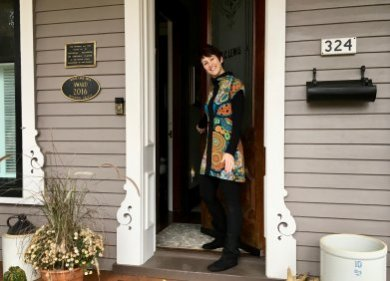 Innkeeper Debi Hillebrand at the door of Lewis House B&B in Whitehall