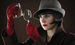 Photo illustration shows woman dressed as detective examining a drinking glass with a magnifying glass