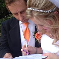 Just-married couple signs wedding certificate
