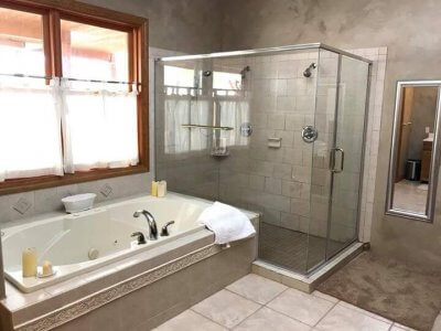 Oak Creek Suite bathroom has a two-person jetted tub and large separate shower.