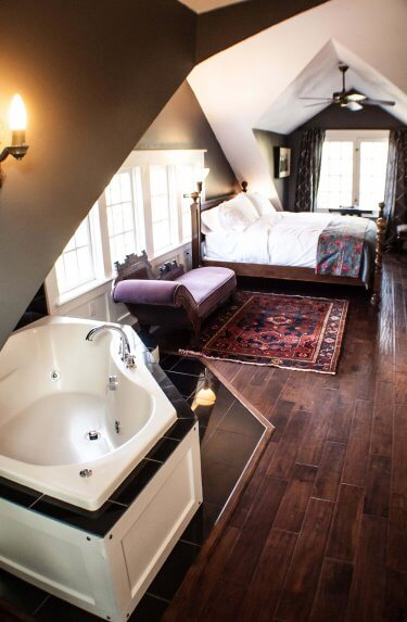 Jagger Room overview, including jetted tub and bed.