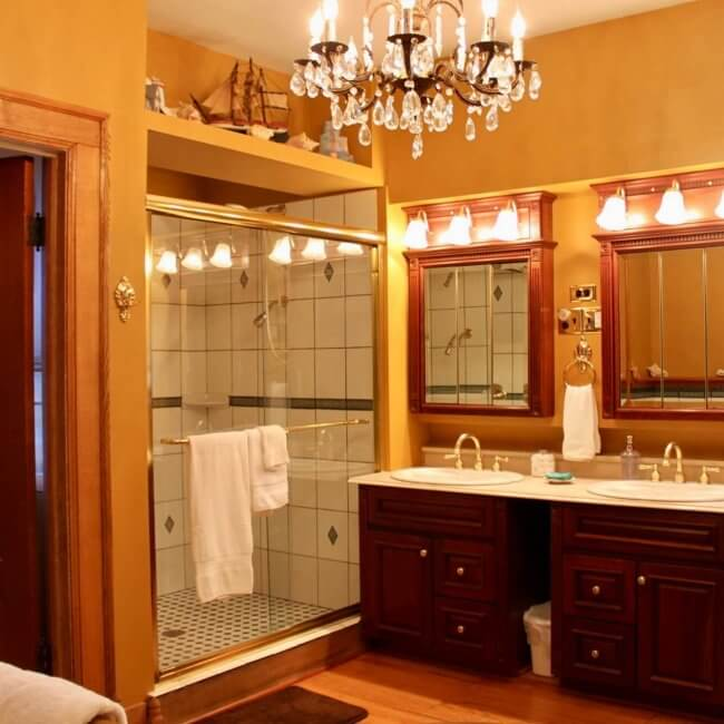 Myer-Rosa Suite at Himelhoch B&B in Caro has a bathroom with a large heated-tile shower, double sinks and a chandelier. Located in the Thumb it's among Michigan inns you need to try.