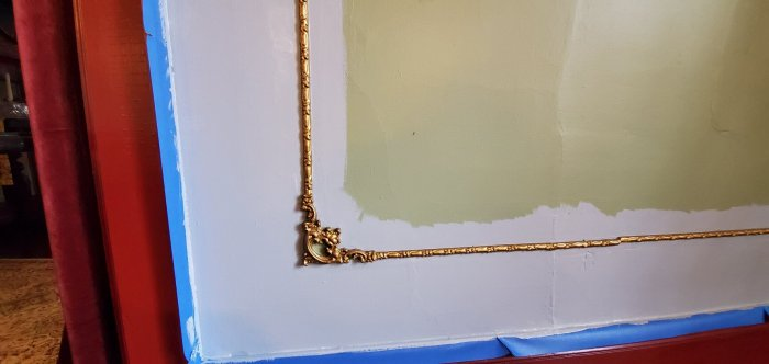 Detail closeup of gold frame molding the innkeepers wanted to preserve