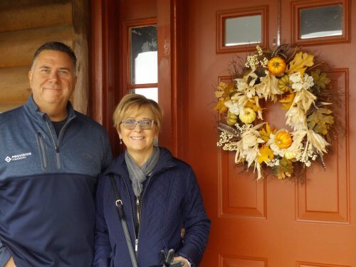 Mike and Liz Clancy at the front door of LogHaven B&B