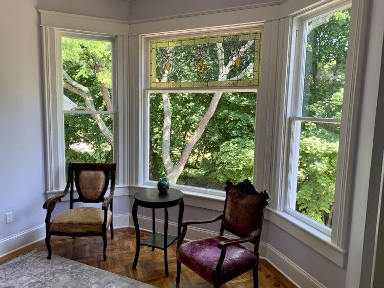 Bay window in Room 3 has two mismatched chairs and a round table.