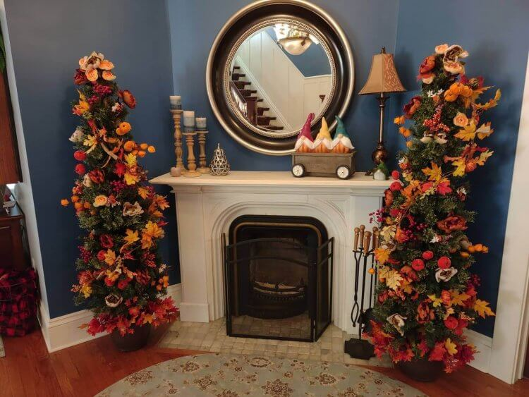Fireplace in the foyer of Nordic Pineapple B&B is decorated for fall