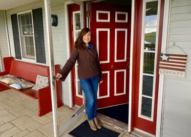 Innkeeper Marci Palajac at her front door
