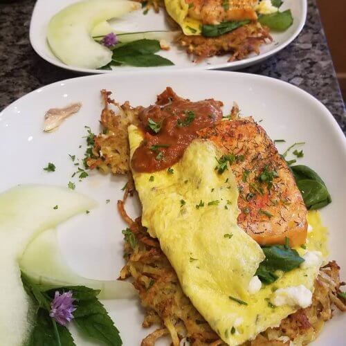 Omelet Florentine with salmon, as served at Judson Heath Colonial Inn.