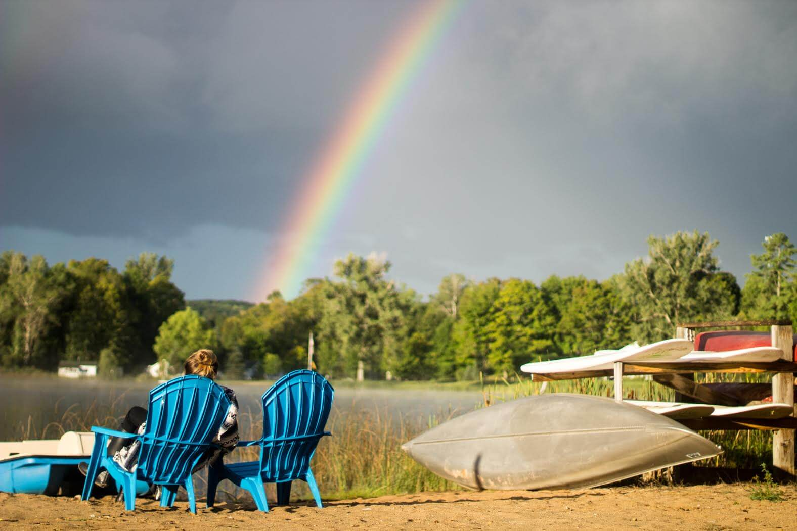 Rainbow and two Adirondack chairs at House on the Hill B&B