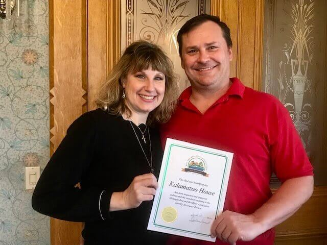 Amy and Jeff Luce of Kalamazoo House hold their MBBA QA certificate.