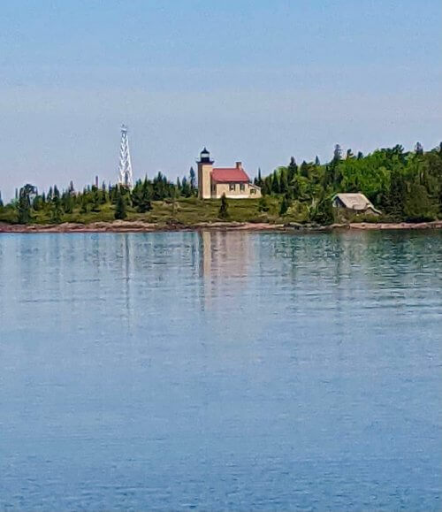 Copper Harbor lighthouse as seen from a park across the harbor
