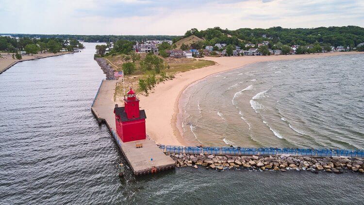 Aerial of Holland Harbor Light on a windy day.