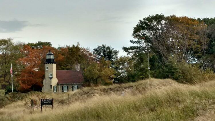 White River Light Station Museum viewed from across the channel connecting White Lake and Lake Michigan