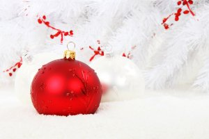 red and white glass Christmas ornaments on a white background